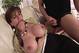 Big tits mature babe sucks on cock