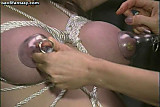 Chained lesbian gets fingered